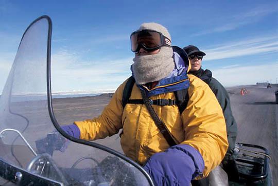 Snowy Owl, (Nyctea scandiaca) Matt Seidensticker and Denver Holt going out to owl nests. Barrow, Alaska.
