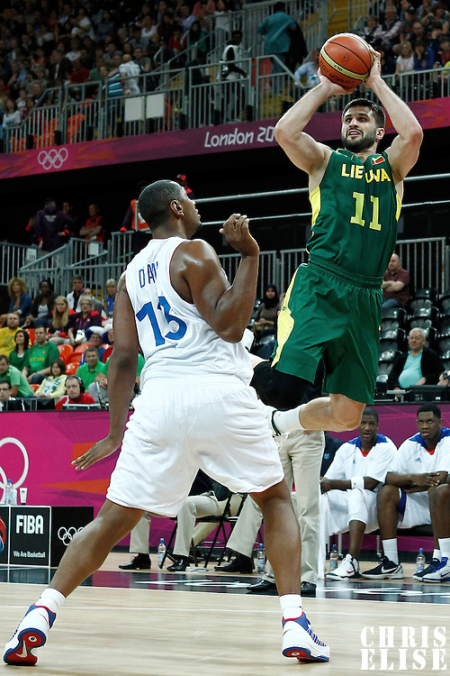 02 August 2012: Lithuania Linas Kleiza takes a jumpshot over Boris Diaw during 82-74 Team France victory over Team Lithuania, during the men's basketball preliminary, at the Basketball Arena, in London, Great Britain.