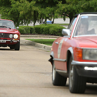 Carlos Rieder and Martina Rieder-Weber, from Switzerland, drive their 1971 Alfa Romeo 2000GT Veloce down 1 Otis Blvd, as they arrive at the Tupelo Automobile Museum on Friday morning. The drivers of the 39 cars stopped in Tupelo Friday morning as part of the The Endurance Rally Association's, Trans American Challenge 2018. The rally started on May 27 in Charleston South Carolina and will end in Seattle on Sunday June 17. The drivers stopped in Tupelo for lunch, rest and a quick tour of the Tupelo Automobile Museum.