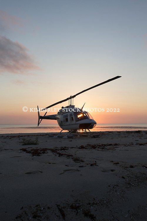 Broome Helicopters's chopper on the sandbank at Adele Island on the Kimberley coast.