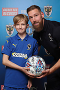 mascot and AFC Wimbledon midfielder Scott Wagstaff (7) during the EFL Sky Bet League 1 match between AFC Wimbledon and Shrewsbury Town at the Cherry Red Records Stadium, Kingston, England on 3 November 2018.