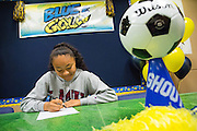 Sarina Bolden poses with a duplicate National Letter of Intent to play soccer at the Loyola Marymount University during the NCAA National Signing Day event at Milpitas High School in Milpitas, California, on February 4, 2015. (Stan Olszewski/SOSKIphoto)