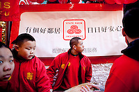 1 February, 2009. New York, NY. Participants of the Chinatown New Year Parade is here on Mott street before the beginning of the parade. New York Senator Kirsten Gillibrand is here on Mott street in Chinatown for the 10th Annual Chinatown Lunar New Year Parade to give a speech in Mandarin.  Sen. Gillibrand learned the language after she spent a semester in China.<br /> <br /> ©2009 Gianni Cipriano for The New York Times<br /> cell. +1 646 465 2168 (USA)<br /> cell. +1 328 567 7923 (Italy)<br /> gianni@giannicipriano.com<br /> www.giannicipriano.com