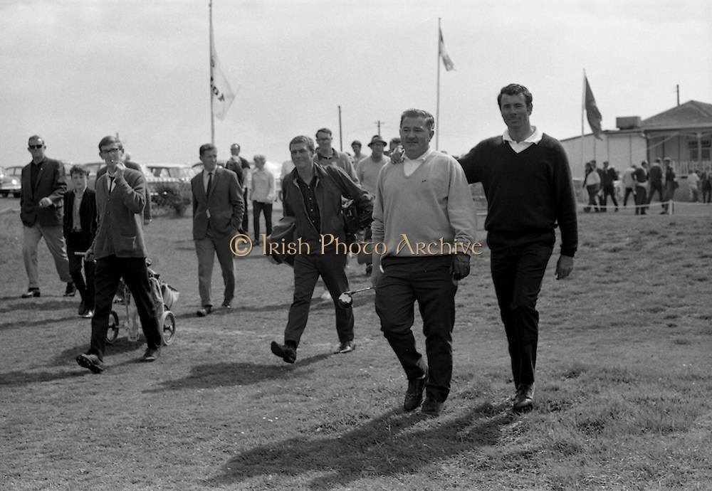 Hugh F. Boyle (right), John Jacobs Golf Centre, sets out on the 2nd round with partner J. Craddock, Foxrock at the Irish Dunlop £1,000 Tournament at Tramore Golf Club, Co. Waterford on the 19th August 1967.