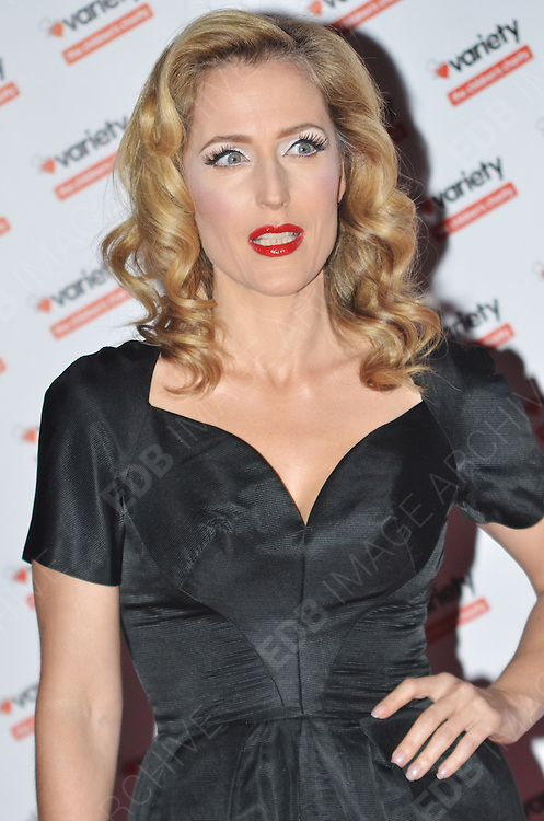 30.NOVEMBER.2011. LONDON<br /> <br /> GILLIAN ANDERSON ATTENDING THE HIDDEN GEMS PHOTOGRAPHY GALA AUCTION HELD AT THE RENAISSANCE ST PANCRAS HOTEL IN LONDON<br /> <br /> BYLINE: EDBIMAGEARCHIVE.COM<br /> <br /> *THIS IMAGE IS STRICTLY FOR UK NEWSPAPERS AND MAGAZINES ONLY*<br /> *FOR WORLD WIDE SALES AND WEB USE PLEASE CONTACT EDBIMAGEARCHIVE - 0208 954 5968*  *** Local Caption ***