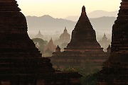 Sunrise view of Pagodas in mist and mountains