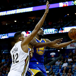 Dec 13, 2016; New Orleans, LA, USA;  Golden State Warriors forward Kevin Durant (35) shoots over New Orleans Pelicans center Alexis Ajinca (42) during the first quarter of a game at the Smoothie King Center. Mandatory Credit: Derick E. Hingle-USA TODAY Sports