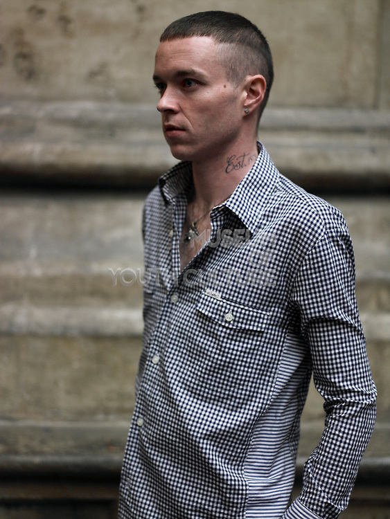 Side Portrait Of Teenager With Tattoo