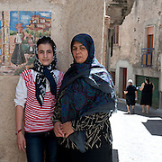 Riace, Calabria, Italia, aug. 2010. Refugees received in Riace. Riace il paese che accoglie rifugiati. Faese (13, Afghanistan) and his mother Mari (41).