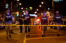 Plainclothes police work at the scene of a mass casualty incident in Toronto, ON, Canada on Sunday, July 22, 2018. A young woman has been killed and 13 others injured in a shooting incident in Toronto, Canadian police say. The Sunday night shooting happened in the Danforth and Logan avenues area. The gunman died in an exchange of fire. Among those injured is a young girl, described as in a critical condition. Police are appealing for witnesses. Photo by Nathan Denette/ABACAPRESS.COM