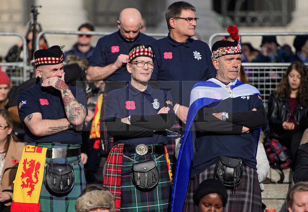© Licensed to London News Pictures. 11/11/2016. London, UK. A group of Scottish football fans wearing poppies, attend Silence in the Square, a service held in Trafalgar Square, London to mark Remembrance Day. A minutes silence is held on the 11th hour of the 11th day of the 11th month, to recall the end of hostilities of World War I.  Photo credit: Ben Cawthra/LNP