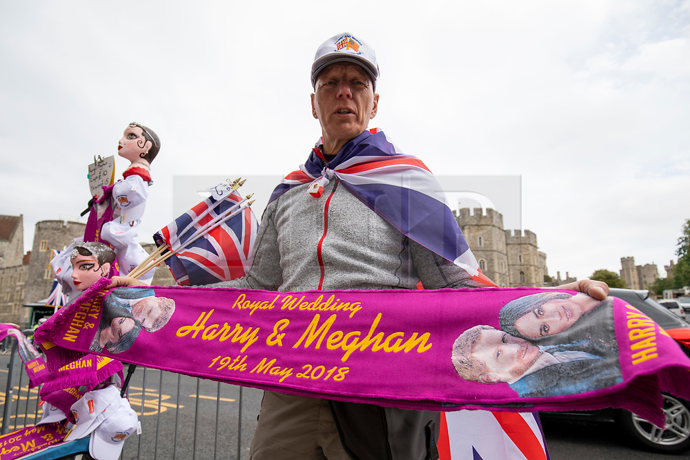 © Licensed to London News Pictures. 16/05/2018. Windsor, UK. Street traders sell Royal Wedding merchandise outside Windsor Castle. Prince Harry and Meghan Markle are to be married on Saturday in Windsor. Photo credit: Rob Pinney/LNP