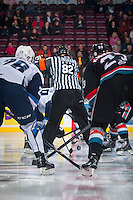 KELOWNA, CANADA - DECEMBER 3: Referee Jeff Ingram drops the puck between the Kelowna Rockets and the Saskatoon Blades on December 3, 2014 at Prospera Place in Kelowna, British Columbia, Canada.  (Photo by Marissa Baecker/Shoot the Breeze)  *** Local Caption *** Jeff Ingram;