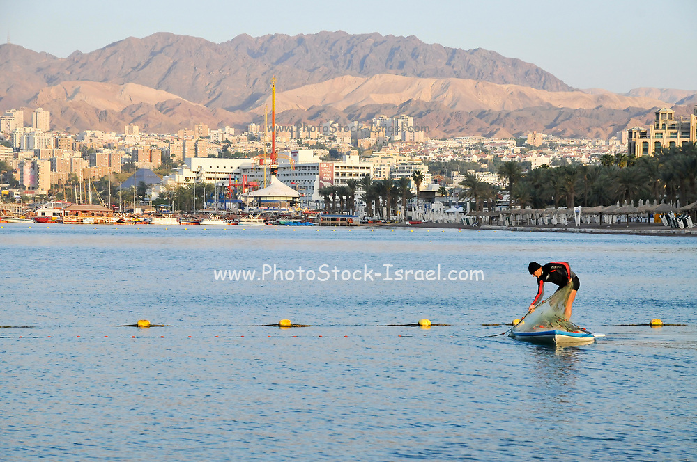 Fisherman fishing in the Red Sea, Eilat, Israel