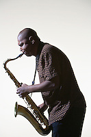 Man Playing Saxophone side view