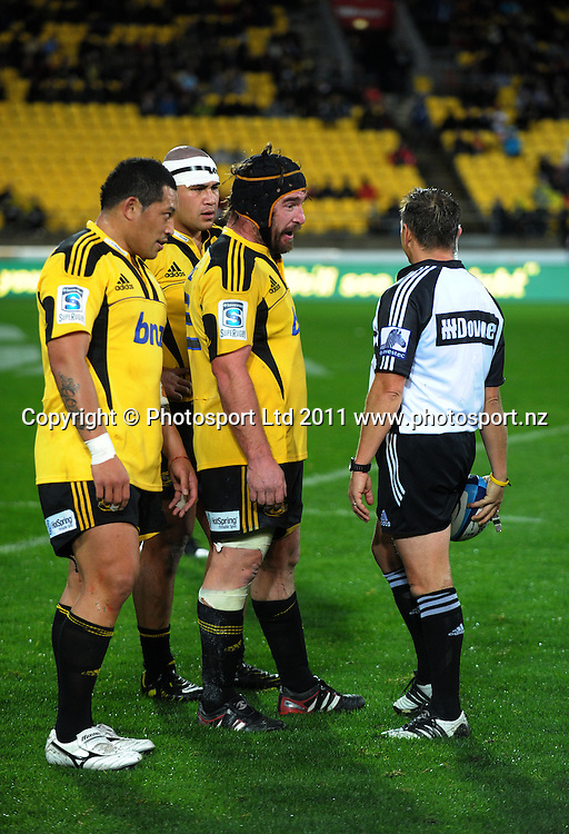 Andrew Hore chats with referee Chris Pollock. Super 15 rugby match - Crusaders v Hurricanes at Westpac Stadium, Wellington, New Zealand on Saturday, 18 June 2011. Photo: Dave Lintott / photosport.co.nz