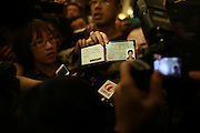 BEIJING, CHINA - MARCH 8: (CHINA OUT)<br /> <br /> Malaysia Airlines Disaster<br /> <br /> A friend of passenger onboard Malaysia Airlines flight MH370 shows the passenger\'s drive licence as he want the media to report on March 8, 2014, in Beijing, China. Malaysia Airline Flight MH370 from Kuala Lumpur to Beijing and carrying 239 onboard was reported missing after the crew failed to check in as scheduled while flying over waters between Malaysia and Ho Chi Minh City in Vietnam.<br /> ©Exclusivepix