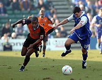 Photo. Leigh Quinnell.  Gillingham v Ipswich Town Coca Cola championship. 24/01/2005.Gillinghams Chris Hope pulls back ipswich's Darren Bent.