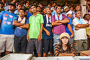 03 NOVEMBER 2012 - HAT YAI, SONGKHLA, THAILAND:   A drink vendor sits in front of spectators watching a bullfight at the bullfighting arena in Hat Yai, Songkhla, Thailand. Bullfighting is a popular past time in southern Thailand. Hat Yai is the center of Thailand's bullfighting culture. In Thai bullfights, two bulls are placed in an arena and they fight, usually by head butting each other until one runs away or time is called. Huge amounts of mony are wagered on Thai bullfights - sometimes as much as 2,000,000 Thai Baht ($65,000 US).     PHOTO BY JACK KURTZ