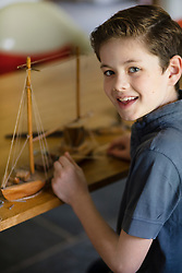 Boy Building Model Ship