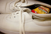 A bag of Metamucil is tucked into a shoe on a chair while its owner taps in her Tip Top Tap class in Sun City December 9, 2009.