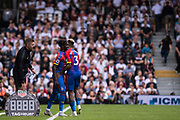 Patrick van Aanholt (3) of Crystal Palace, Crystal Palace (27) Pape Souare during the Premier League match between Fulham and Crystal Palace at Craven Cottage, London, England on 11 August 2018.
