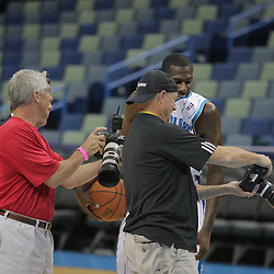 26 September 2008: Photographers show Julian Wright a preview of their shots during media day for the New Orleans Hornets at the New Orleans Arena in New Orleans, LA.