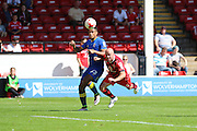 AFC Wimbledon striker Lyle Taylor (33) and Walsall FC defender James O'Connor (4) tussle during the EFL Sky Bet League 1 match between Walsall and AFC Wimbledon at the Banks's Stadium, Walsall, England on 6 August 2016. Photo by Stuart Butcher.