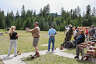 Woman Trap shooting using a convertible wheelhair.