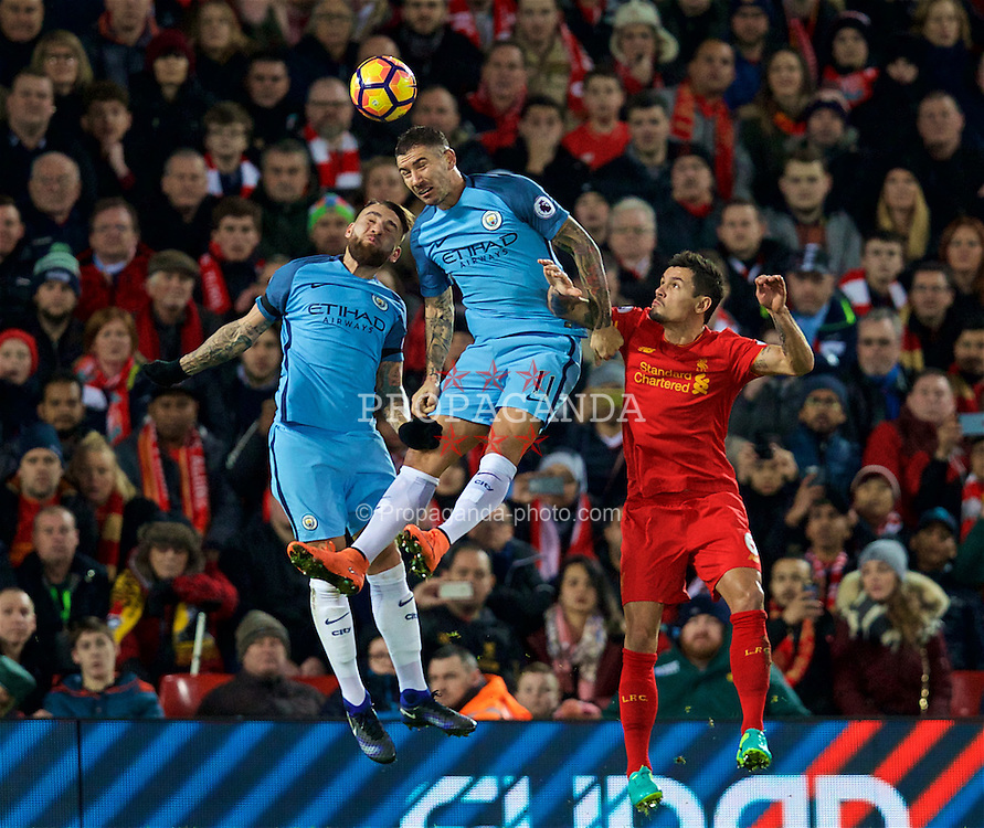 LIVERPOOL, ENGLAND - Saturday, December 31, 2016: Liverpool's Dejan Lovren in action against Manchester City's Nicolas Otamendi and Roberto Firmino during the FA Premier League match at Anfield. (Pic by David Rawcliffe/Propaganda)