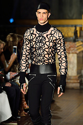 © Licensed to London News Pictures. 20/02/2016. Model on the catwalk at the JULIEN MACDONALD Autumn/Winter 2016 show. Models, buyers, celebrities and the stylish descend upon London Fashion Week for the Autumn/Winters 2016 clothes collection shows. London, UK. Photo credit: Ray Tang/LNP