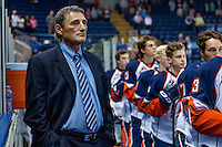 KELOWNA, CANADA - AUGUST 30:  Don Hay, head coach of the Kamloops Blazers stands on the bench during the national anthem against the Kelowna Rockets on August 30, 2014 during pre-season at Prospera Place in Kelowna, British Columbia, Canada.   (Photo by Marissa Baecker/Shoot the Breeze)  *** Local Caption *** Don Hay