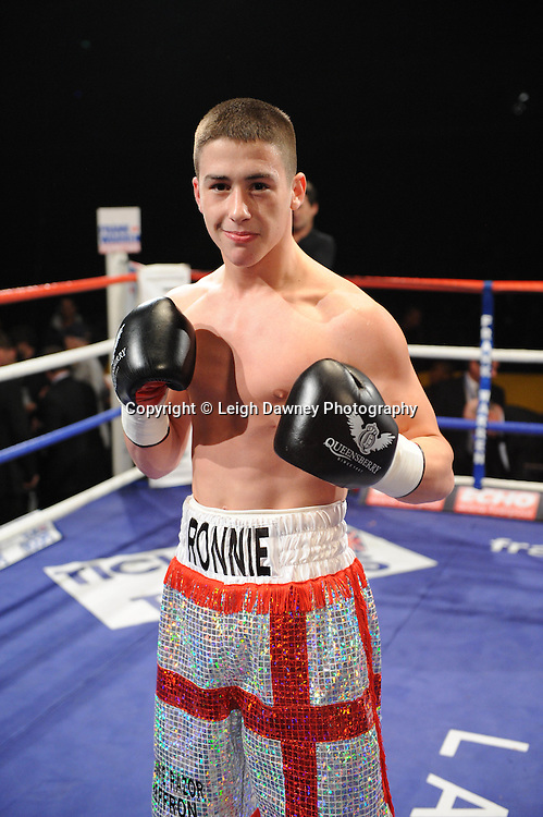 Ronnie Heffron (George Cross shorts) defeats Wayne Downing at the Echo Arena, Liverpool on 11th December 2010. Frank Warren Promotions. Photo credit © Leigh Dawney.
