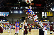 05 May 2006: High flier Kris Bruton (26) goes for a soaring dunk over the referee during the Harlem Globetrotters vs the New York Nationals at the Sulivan Arena in Anchorage Alaska during their 80th Anniversary World Tour.