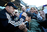 "Actor Kevin James signs the forehead with a sharpie of mega fan, Rose Atkinson, 9, during the Colorado premiere of ""Here Comes the Boom"" at the United Artists Colorado Center 9 on Oct. 4. Other celebrities who appeared at the Red Carpet event included renowned mixed-martial arts fighter Bas Rutten and MMA fighters Nate Marquardt, Michelle Blalock and Jason ""The Dragon"" Lee. (Photo by Jamie Cotten)"