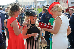 LIVERPOOL, ENGLAND - Thursday, April 9, 2015: Female race-goers during Grand Opening Day on Day One of the Aintree Grand National Festival at Aintree Racecourse. (Pic by David Rawcliffe/Propaganda)