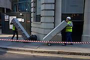Workmen deliver staff security lockers to a new City of London business development.