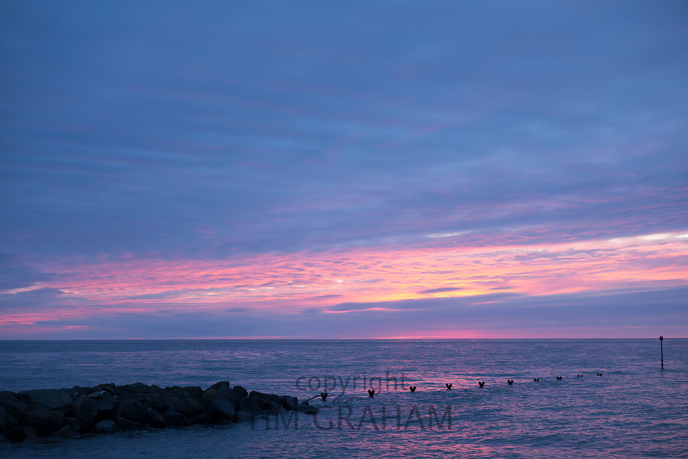 Breathtaking, spectacular pastel colours of setting sun above the Atlantic Ocean in Wales