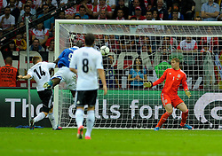 Mario Balotelli scores his team's first goal during the UEFA EURO 2012 semi final match between Germany and Italy at the National Stadium on June 28, 2012 in Warsaw, Poland.