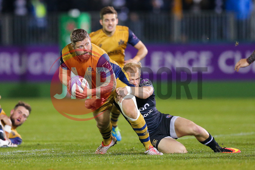 Chris Brooker of Bristol Rugby is tackled by Will Homer of Bath Rugby - Rogan Thomson/JMP - 20/10/2016 - RUGBY UNION - The Recreation Ground - Bath, England - Bath Rugby v Bristol Rugby - EPCR Challenge Cup.