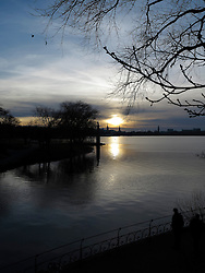 GERMANY HAMBURG 31DEC13 - A lone man glances into the sunset over the Aussenalster in Hamburg prior to New Year's Eve.<br /> <br /> <br /> <br /> jre/Photo by Jiri Rezac<br /> <br /> <br /> <br /> © Jiri Rezac 2013