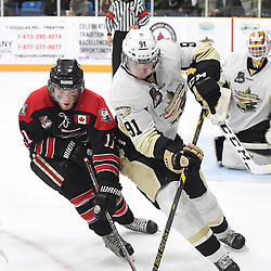 TRENTON, ON - Apr 22, 2016 -  Ontario Junior Hockey League game action between the against the Trenton Golden Hawks and the Georgetown Raiders. Game 5 of the Buckland Cup Championship Series, at the Duncan Memorial Gardens in Trenton, Ontario. Bailey Molella #11 of the Georgetown Raiders battles for control with Mac Lewis #91 of the Trenton Golden Hawks during the third period.<br /> (Photo by Andy Corneau / OJHL Images)