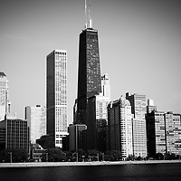Black and white Chicago skyline with John Hancock Center skyscraper building. Scene is located in the Northern Streeterville area of Chicago with lake Michigan in the forground.