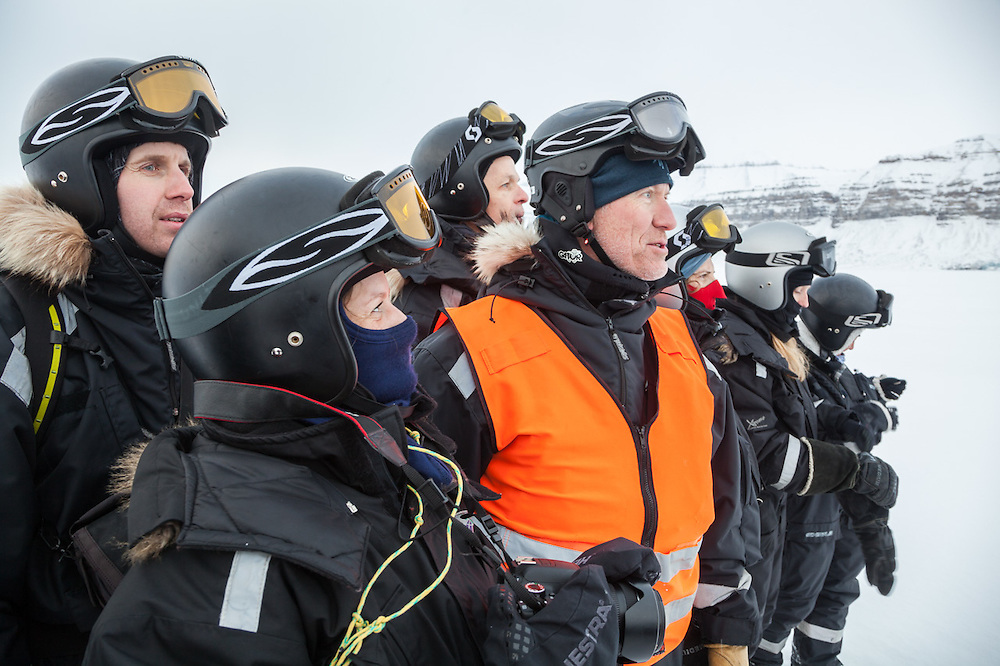 UNIS students stand with their guide (center) to watch for polar bears on the sea ice in Templefjorden, Svalbard.