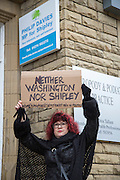 Protester outside Philip Davies MP office. Rally against Donald Trump, USA president elect on his first day in office, in the market town of Shipley in West Yorkshire. Protesters marched past the office of Philip Davies MP, a strong supporter of Trump and Brexit. Philip was the first MP to publicly call for Britain to withdraw from the European Union and is a member of The Freedom Association's 'Better Off Out' campaign and recently sits on the women and equalities committee in the UK government.