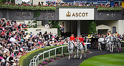 © Licensed to London News Pictures. 19/06/2018. London, UK.  Members of the Royal Family, including Queen Elizabeth II and Meghan, Duchess of Sussex,  arrive for Day one of Royal Ascot at Ascot racecourse in Berkshire, on June 19, 2018. The 5 day showcase event, which is one of the highlights of the racing calendar, has been held at the famous Berkshire course since 1711 and tradition is a hallmark of the meeting. Top hats and tails remain compulsory in parts of the course. Photo credit: Ben Cawthra/LNP