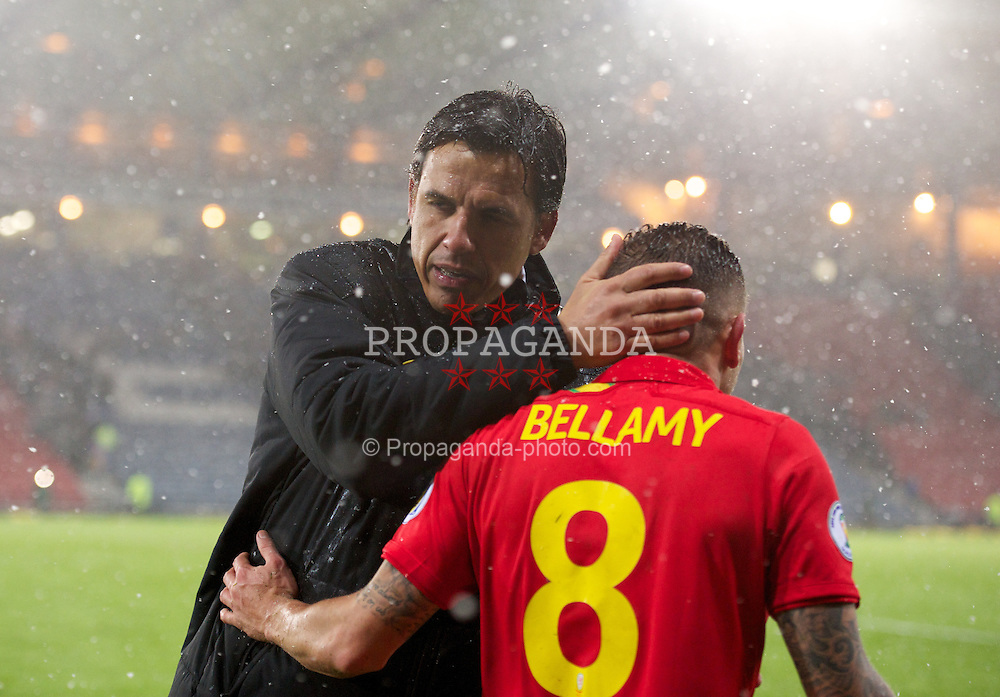 GLASGOW, SCOTLAND - Friday, March 22, 2013: Wales' manager Chris Coleman and Craig Bellamy after the 2-1 victory over Scotland during the 2014 FIFA World Cup Brazil Qualifying Group A match at Hampden Park. (Pic by David Rawcliffe/Propaganda)