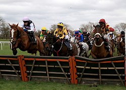 Poker Play ridden by Tom Scudamore cleras a hurdle along side Coeur Blimey ridden by Lucy Gardner (Centre) and Buckhorn Timothy ridden by Richard Johnson before winning the Marstons Pedigree Handicap Hurdle race at Uttoxeter Racecourse.
