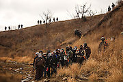 Authorities face protestors as they block them from proceeding further towards the construction site of the Dakota Access Pipeline on Army Corps of Engineers land in Cannon Ball, North Dakota in November 2016.<br />