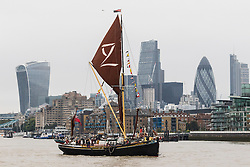 © Licensed to London News Pictures. 17/09/2016. LONDON, UK.  Sailing barges (Lady Daphne in front) parade on the River Thames, passing under Tower Bridge in London for the first ever Thames Sailing Barge Parade. The event aims to recreate scenes from Londonís days as a bustling trading port and the historic sailing barges taking part have not been seen together in one place since the industrial revolution.  Photo credit: Vickie Flores/LNP